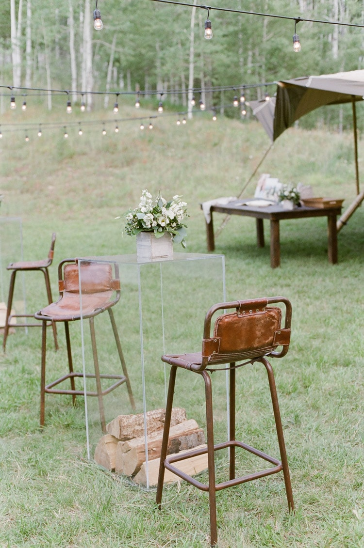 Leather high top chairs at an outdoor wedding reception in Vail Colorado