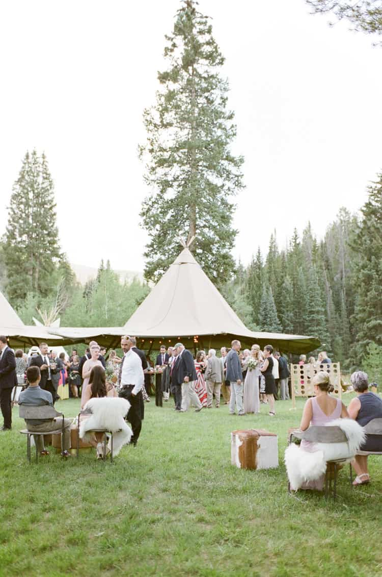 Guest Enjoying Cocktail At Eaton Ranch Wedding In Vail With Bella Event Design And Planning