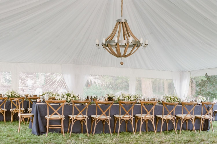 Tented reception at Eaton Ranch in Vail featuring a beautiful oversized chandelier