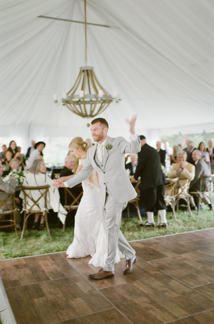 Couple dancing at their tented wedding reception at Eaton Ranch in Vail Colorado