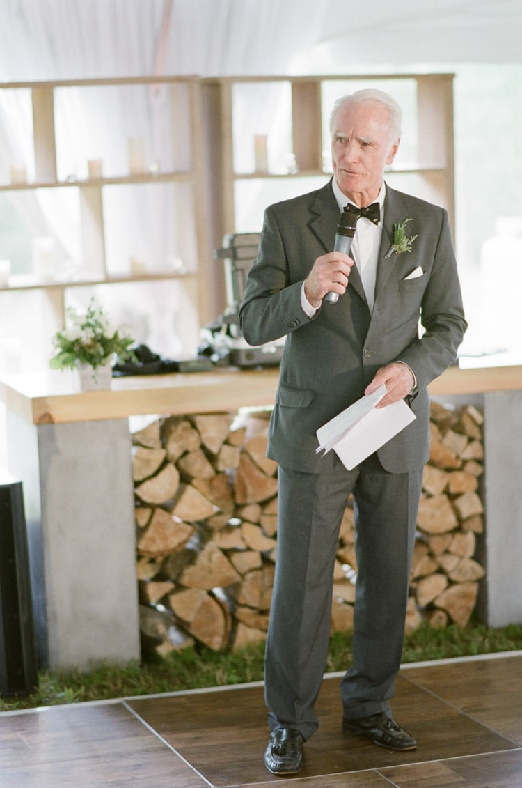 Man gives speech at a wedding reception at Eaton Ranch in Vail