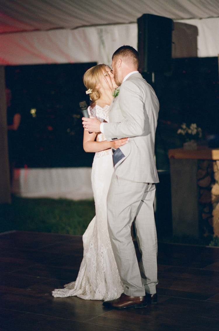 Bride and groom share a dance during their wedding reception at Eaton Ranch in Vail