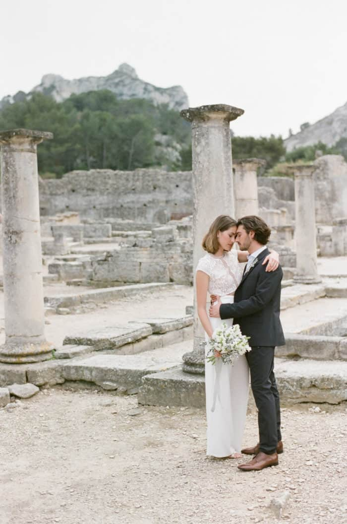 Bride wearing a two piece outfit at Glanum Ruins in Provence