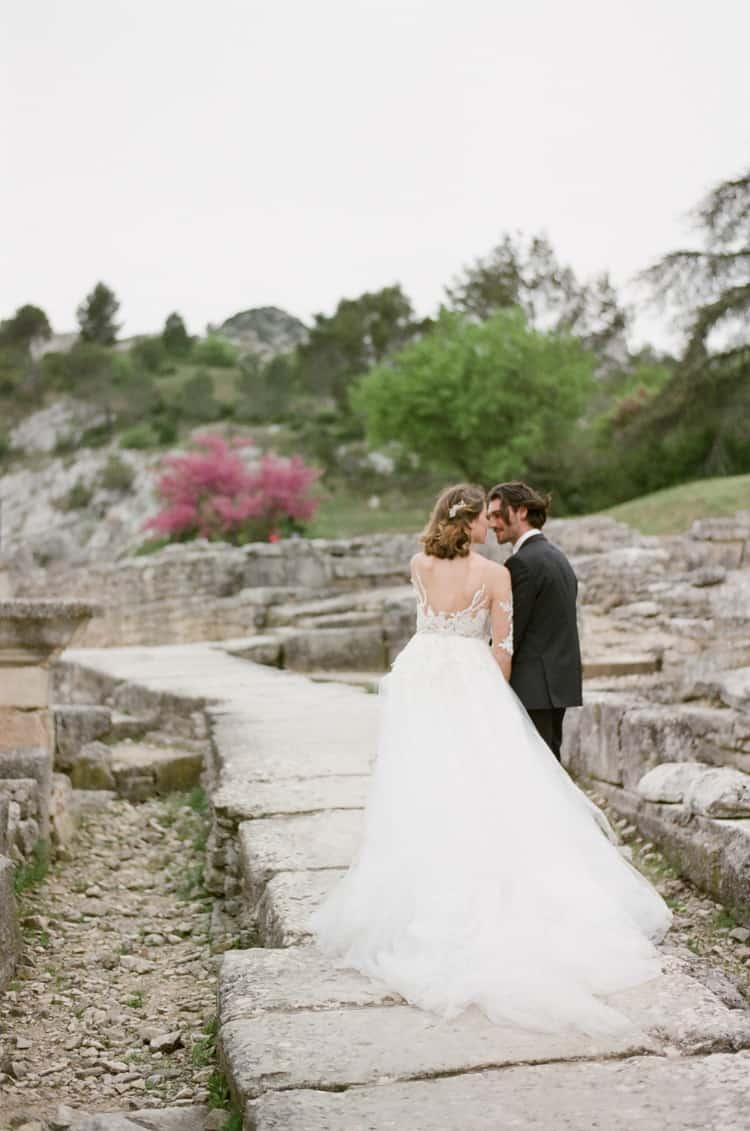 Bride And Groom Walking Along Glanum Ruins At Tamara Gruner Workshops