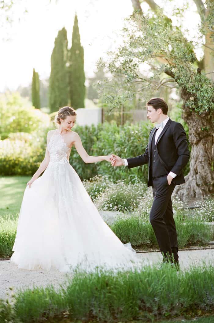 Wedding Couple Walking together holding hands at private estate Le Clos Saint Esteve for wedding portraits