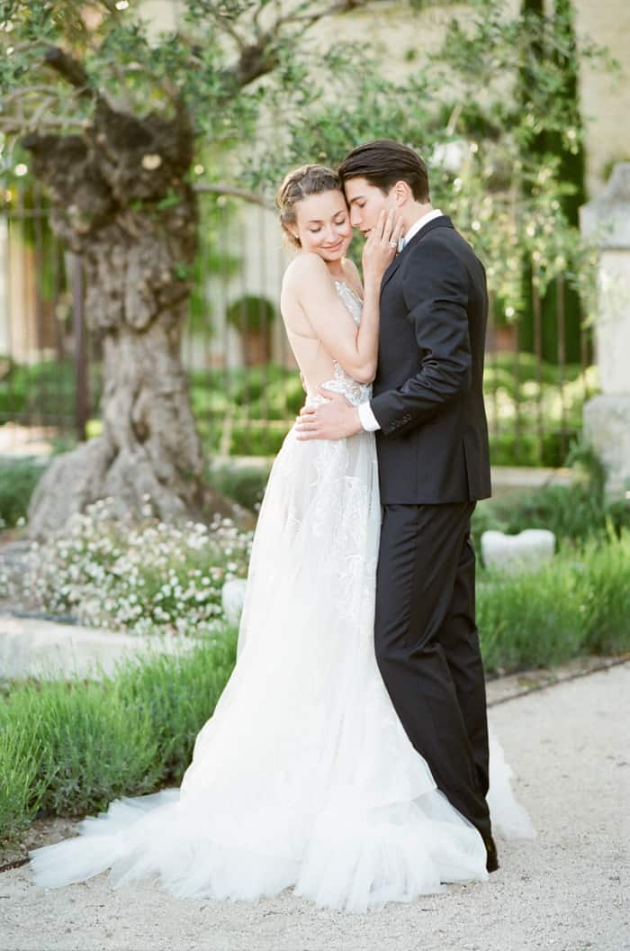 Styled soiree of romantic wedding of couple embracing each other