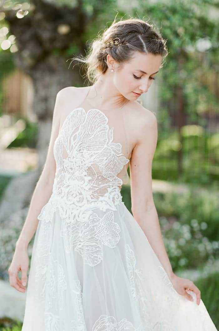 Bride showing of her Musat Official Wedding Dress featuring soft tulle, lace elements, and unique illusion bodice