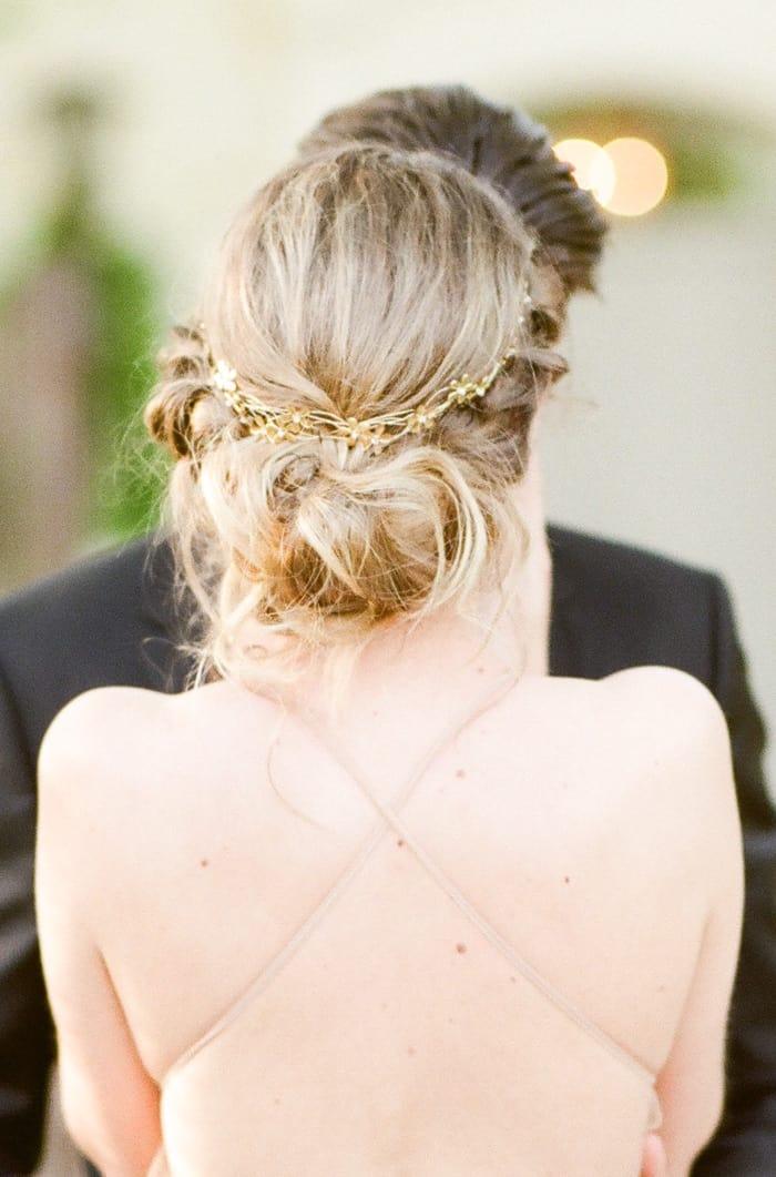 Bride facing away revealing behind view of wedding gown
