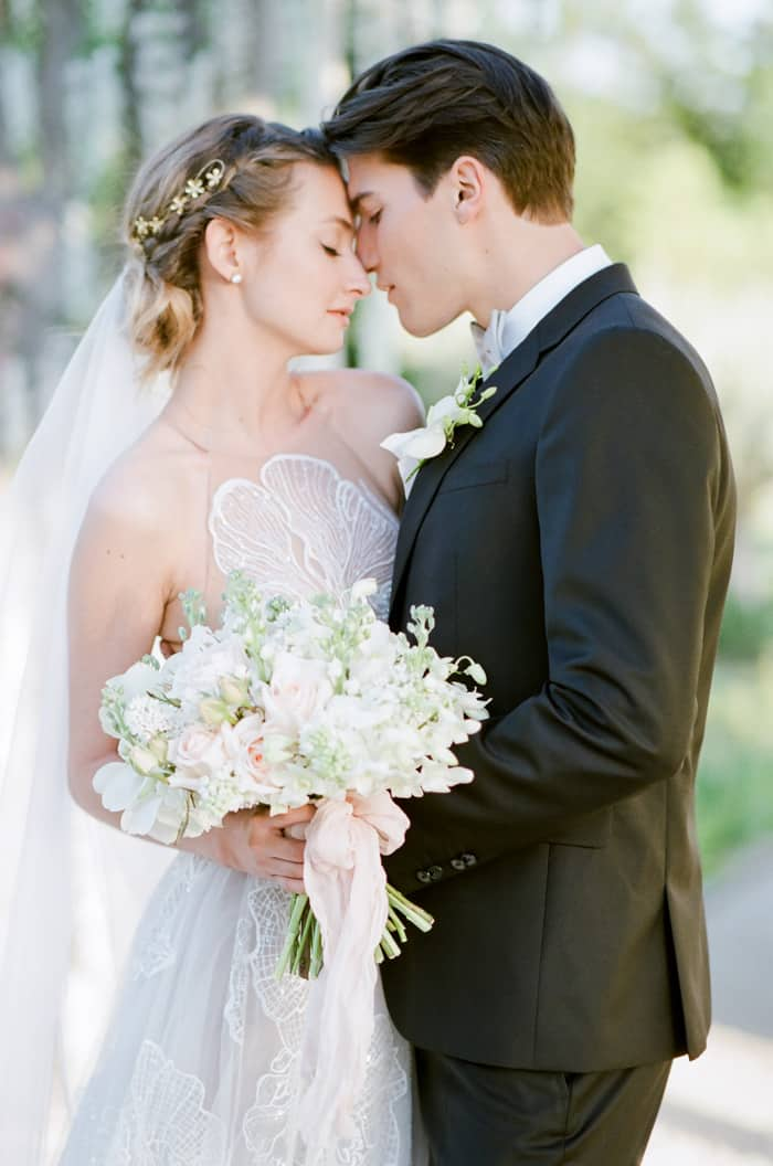 Man and woman facing close to each other romantically about to kiss