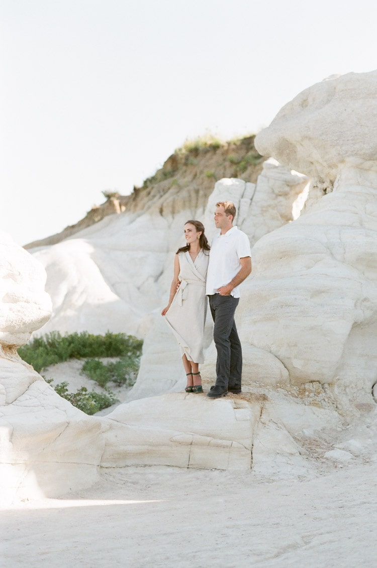 Bride and groom pose for engagement portraits at The Paint Mines Interpretive Park in Colorado