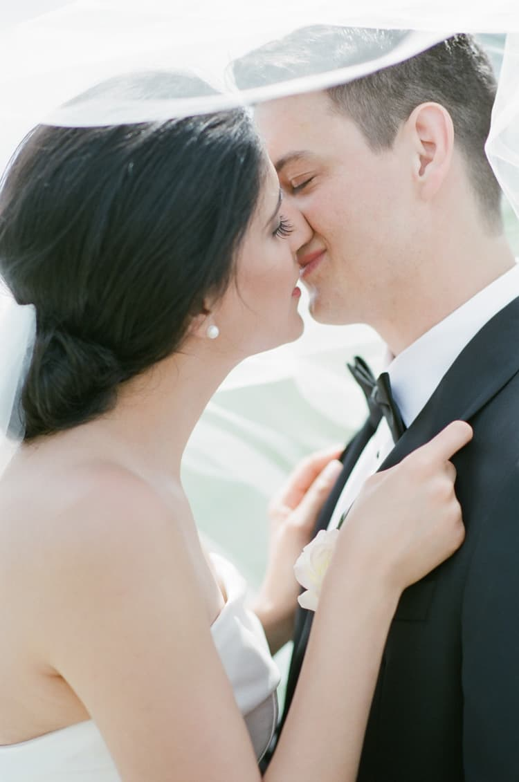 Bride and groom kissing during wedding portraits in Vail