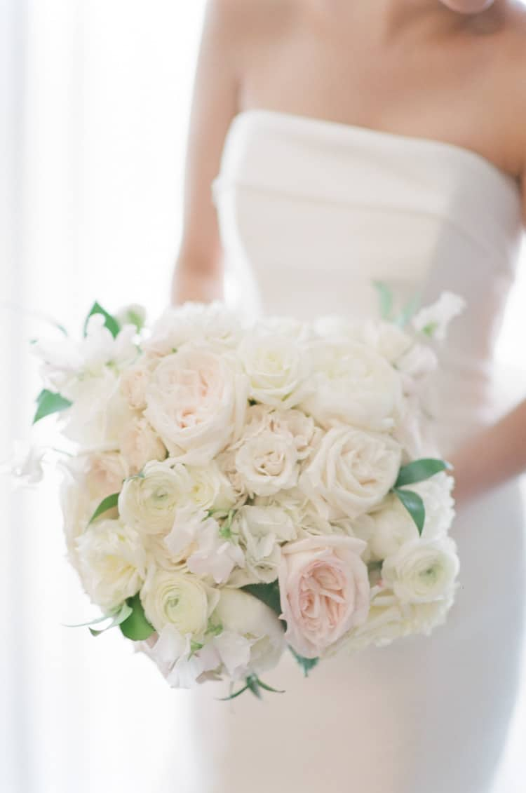 Bride holding a white bouquet at The Four Seasons Vail