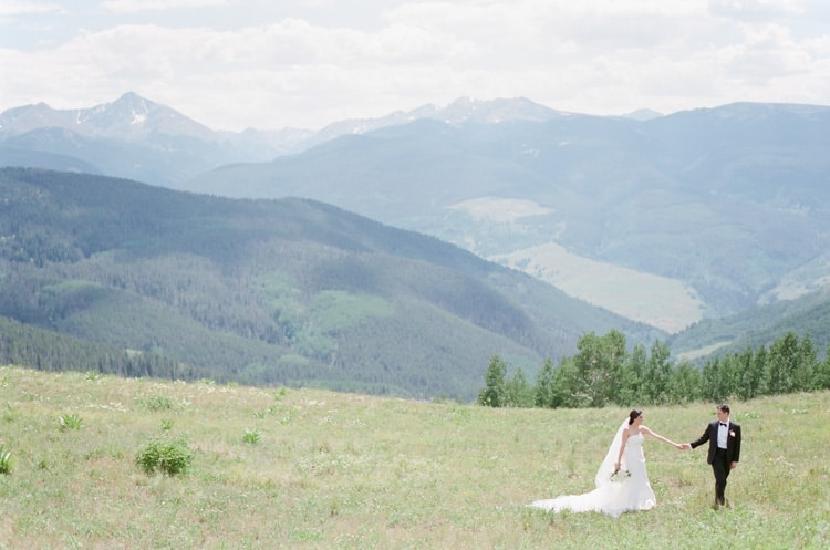 Outdoor wedding portraits by the mountains in Vail Colorado