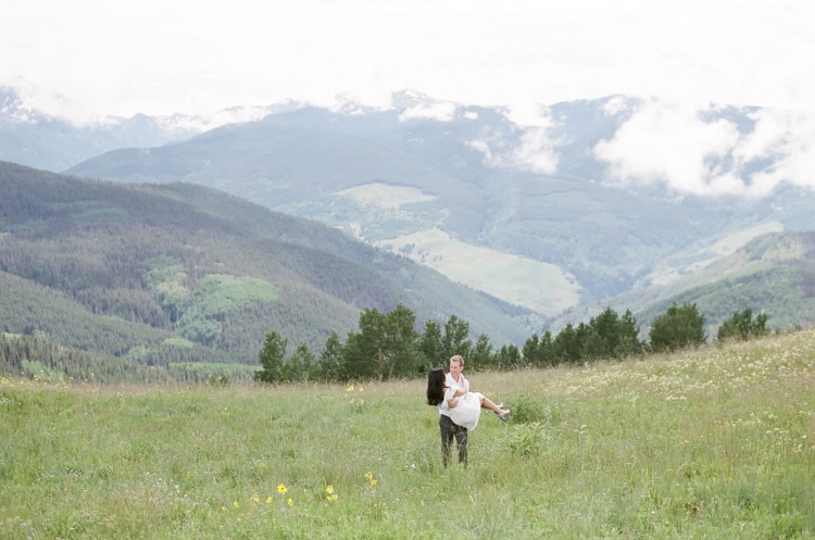 Engagement session with mountain views and misty clouds in between ranges in the background