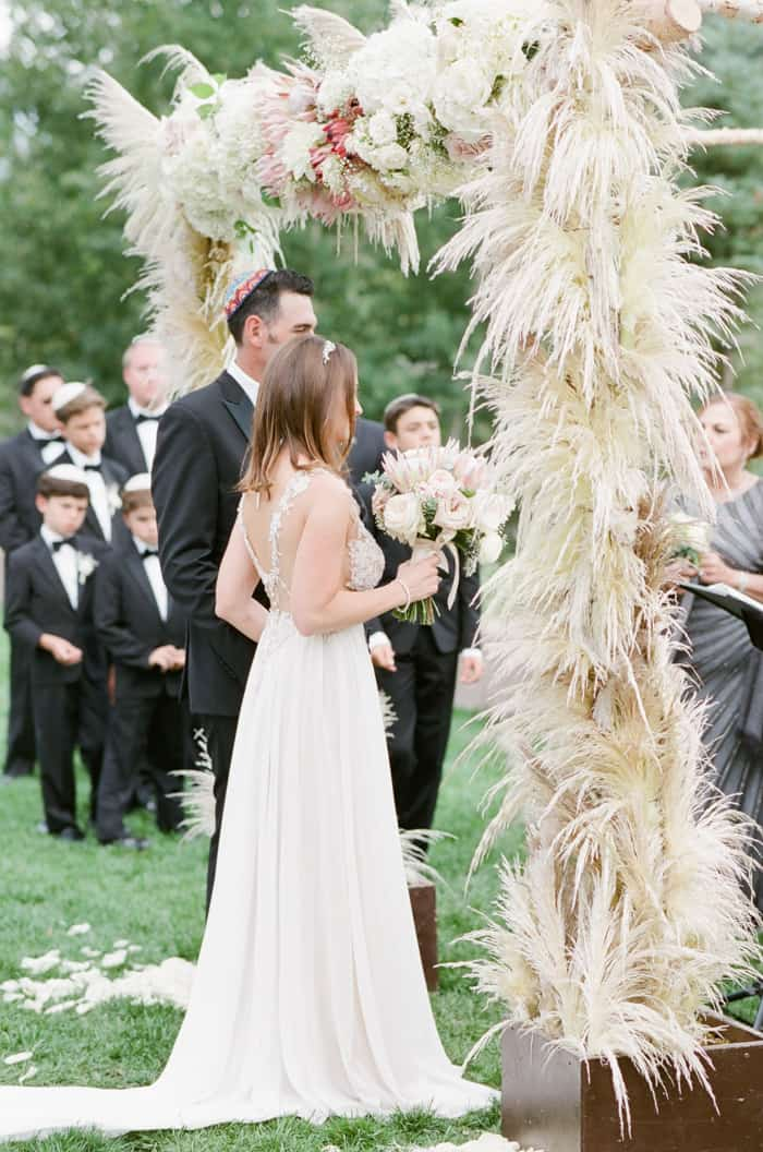 Bride And Groom During Ceremony At Jewish Wedding At The Westin Riverfront And Spa In Beaver Creek With Calluna Events