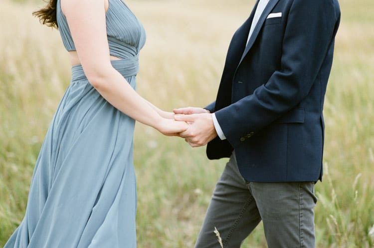 Bride and Groom To Be Holding Each Others Hands In Front Of Flatirons In Boulder Planned By Cloud9 Bliss
