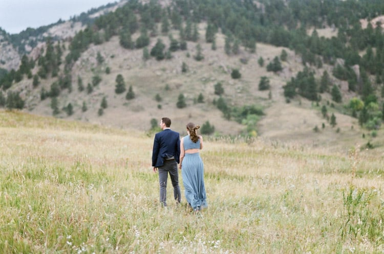 Bride and Groom Enjoying Mountain Views In Front Of Flatirons In Boulder Planned By Cloud9 Bliss