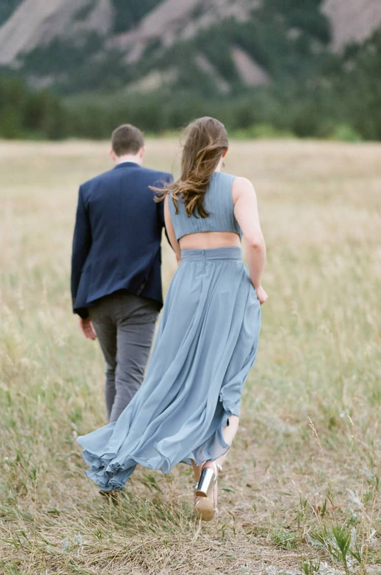 Bride and Groom Walking In Front Of Flatirons In Boulder Planned By Cloud9 Bliss