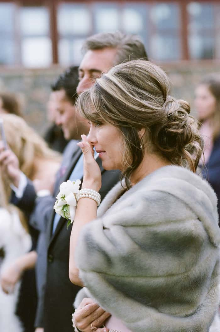 People in the crowd during winter wedding ceremony in Colorado