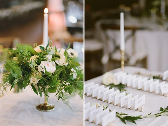Floral centerpiece with candle and escort cards