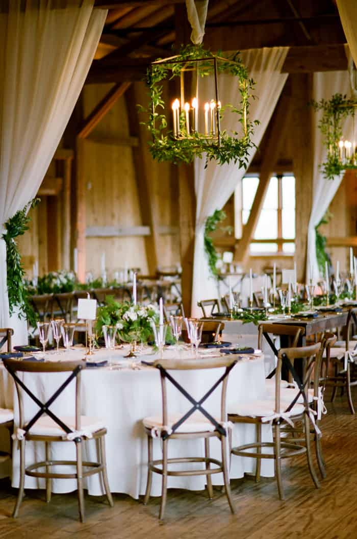 Rustic ranch style building with wedding reception tables