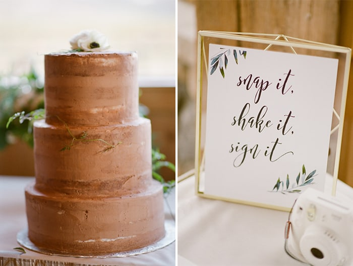 """Chocolate three-tiered cake and sign with white camera saying """"snap it, shake it, sign it"""""""