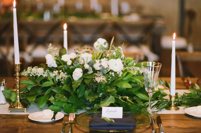 White floral centerpiece at Devil's Thumb Ranch wedding reception