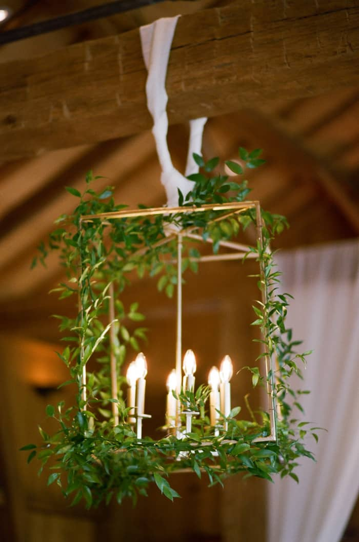 Hanging lantern decorated with greenery and candles
