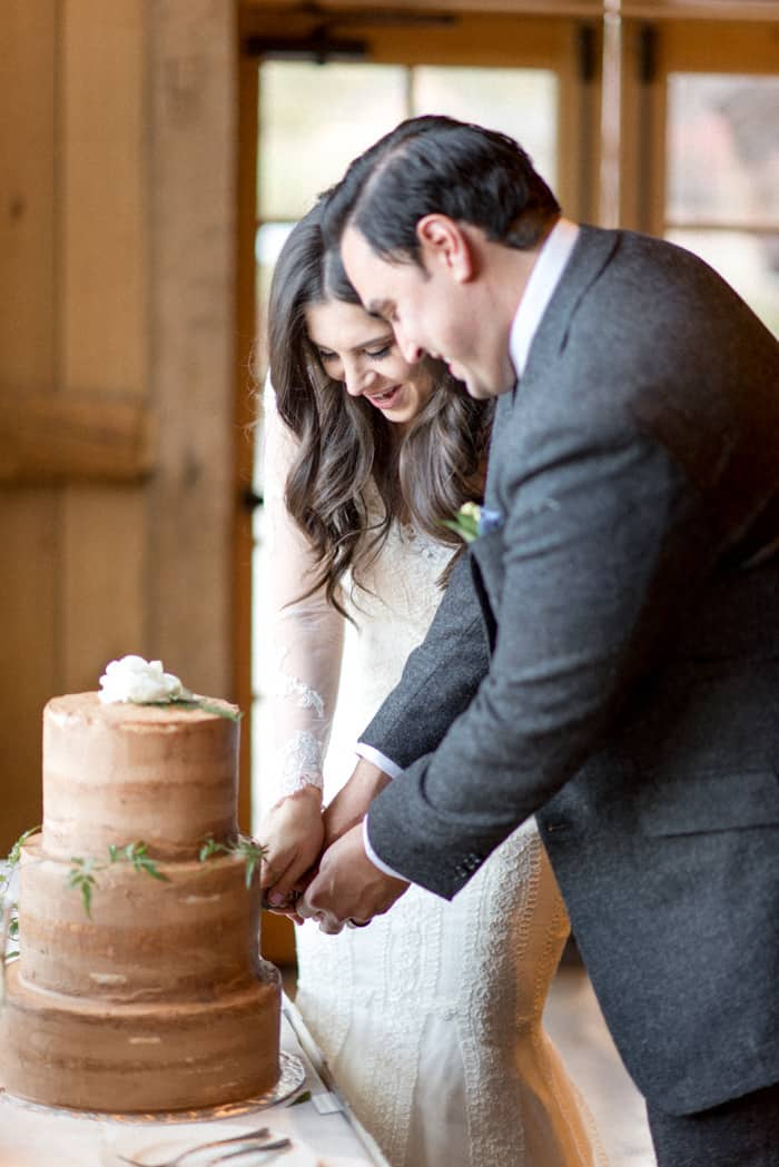 Cutting of the cake at Colorado wedding reception