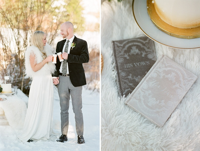 Couple clinking coffee mugs in snow together and little his & her vows booklets on the right