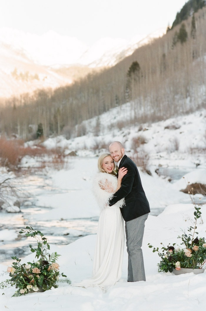 Engagement session couple posing in snow during the winter