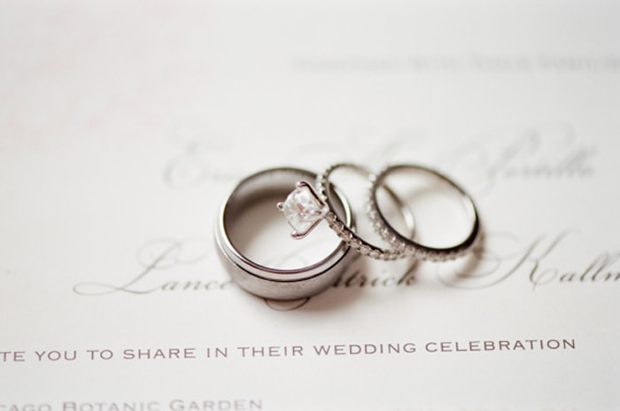 Wedding rings on an invitation suite for a ceremony at the Chicago Botanic Garden