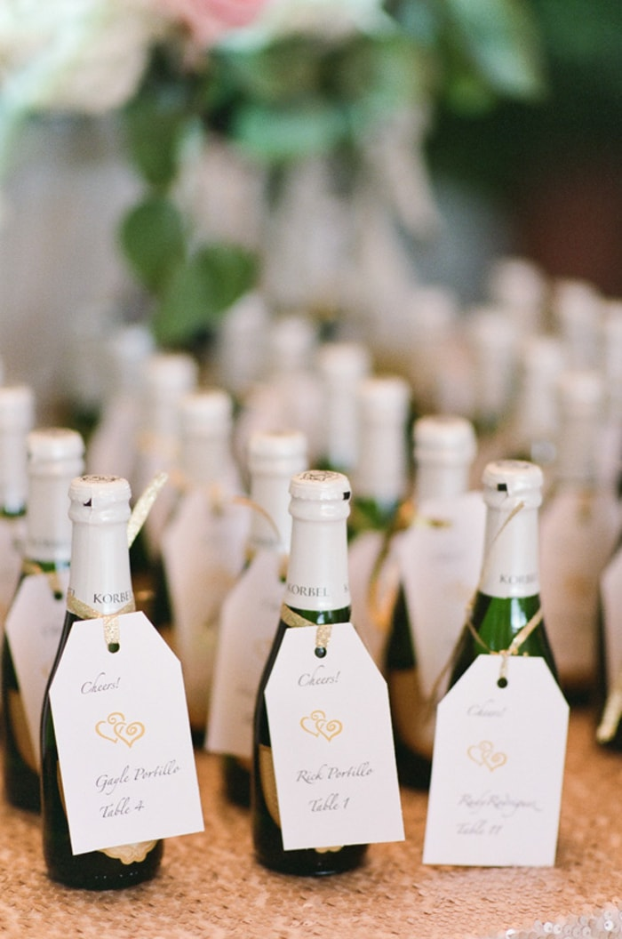 Mini champagne bottles with tags at a Chicago Botanic Garden wedding reception