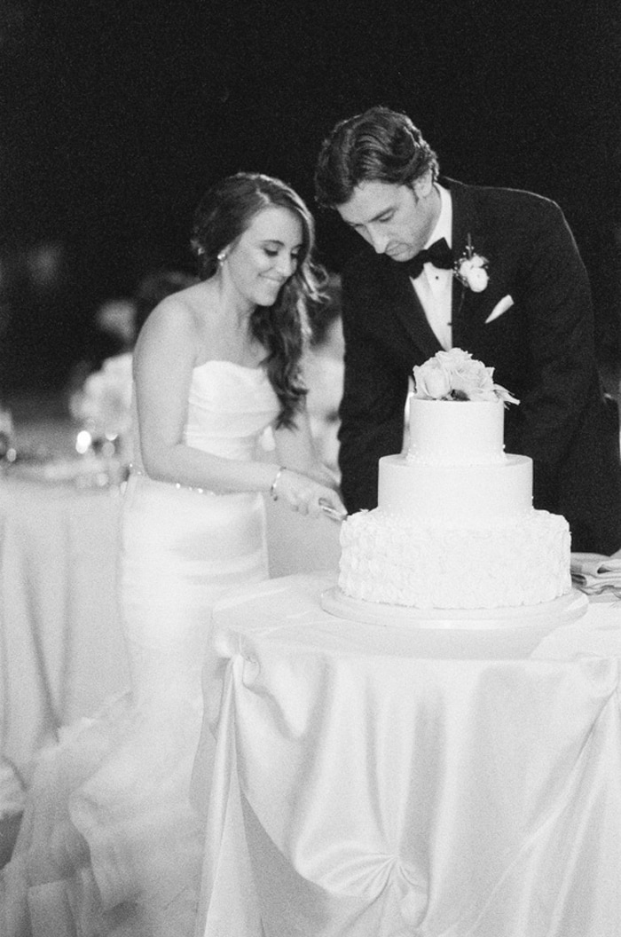 Bride and groom cut the cake during their wedding reception at the Chicago Botanic Garden