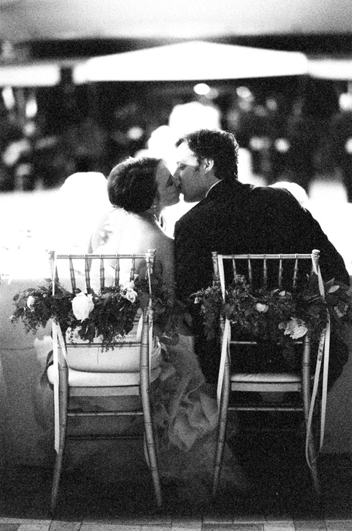 Bride and groom kiss during their wedding reception at the Chicago Botanic Garden