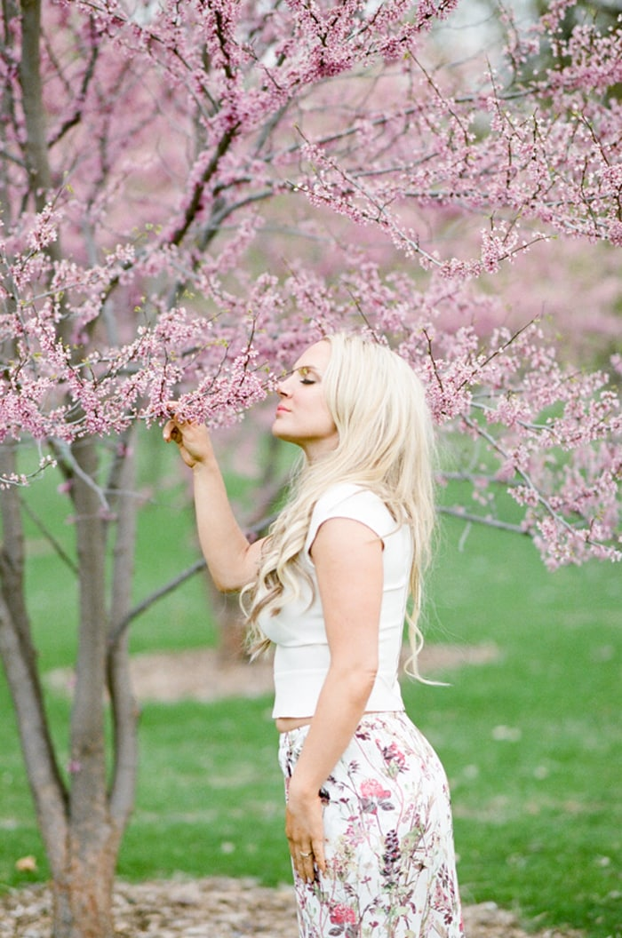 Woman admiring cherry blossoms in Denver Colorad
