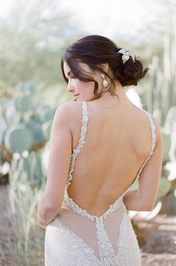 Backless Galia Lahav dress worn by woman