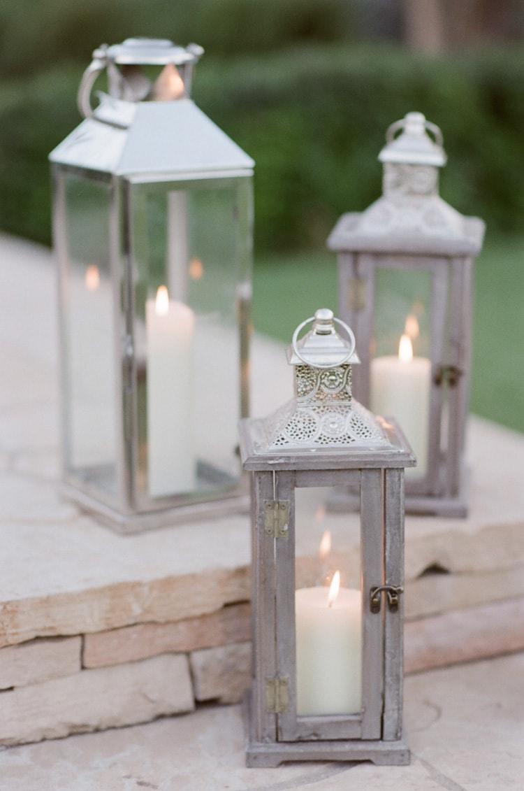Wood and metal lanterns burning candles inside
