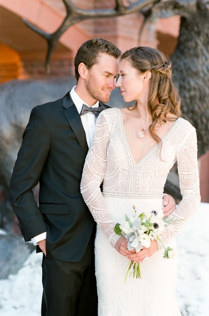 Bride and groom touching foreheads at a winter wedding at the St Regis Aspen