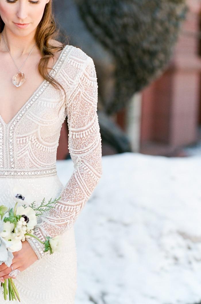 Bride wearing Berta Bridal wedding dress embellished with pearls