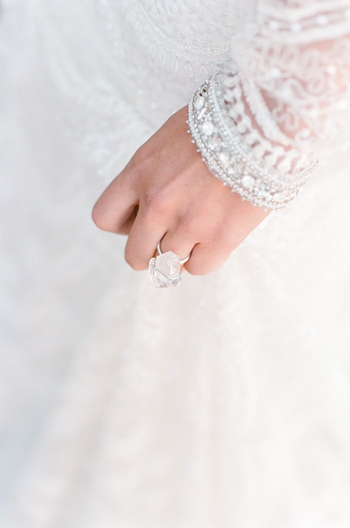 Close up of hand with large crystal ring