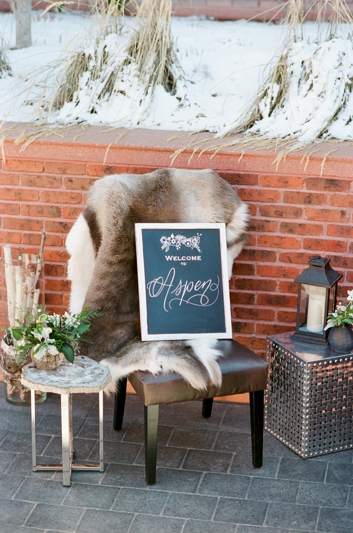 Welcome to Aspen written on chalkboard with surrounding decor for styled shoot