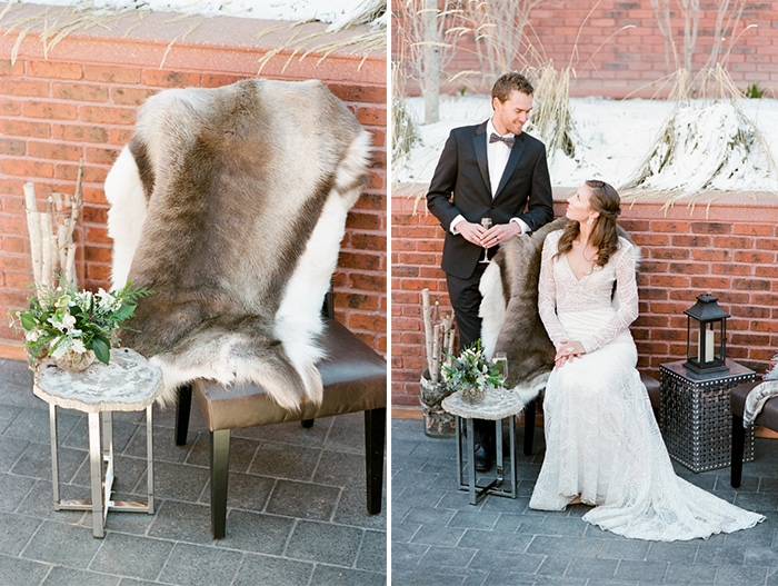 On the left fur hanging over chair and on the right bride sitting down and groom standing up both looking at each other