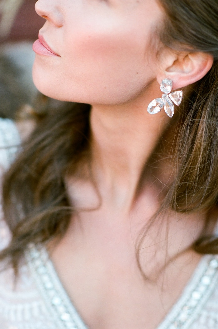 Close up of woman's crystal flower earring