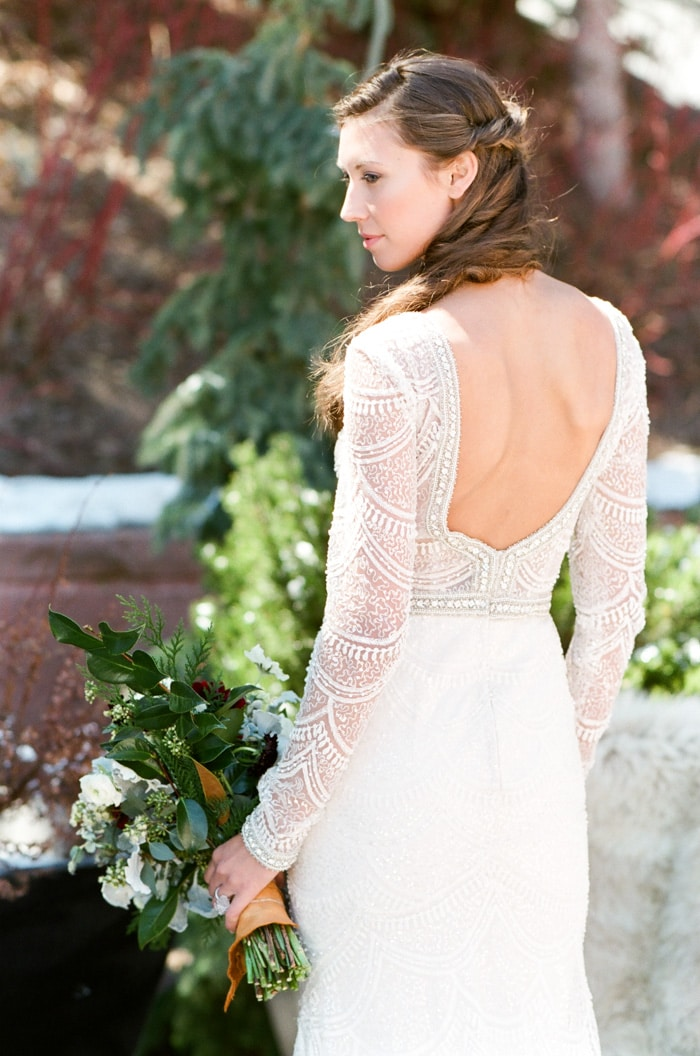 Wife-to-be wearing backless white wedding gown