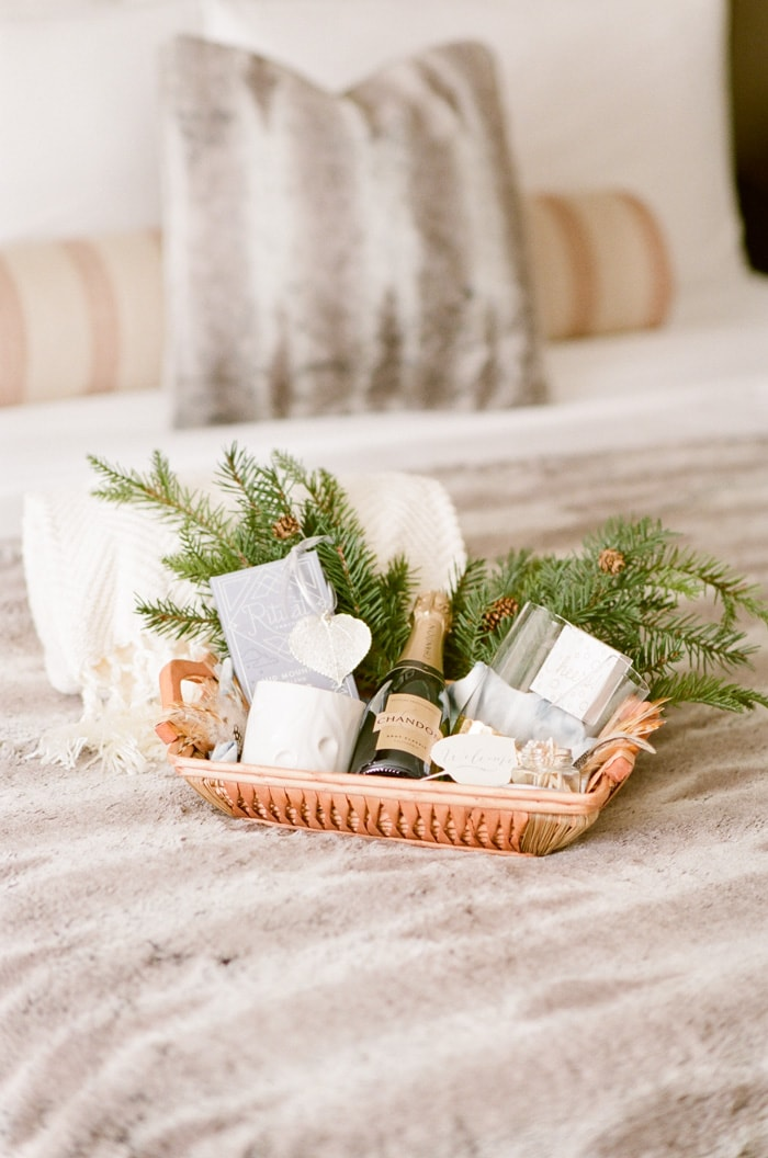 Wedding gift basket laying on bed