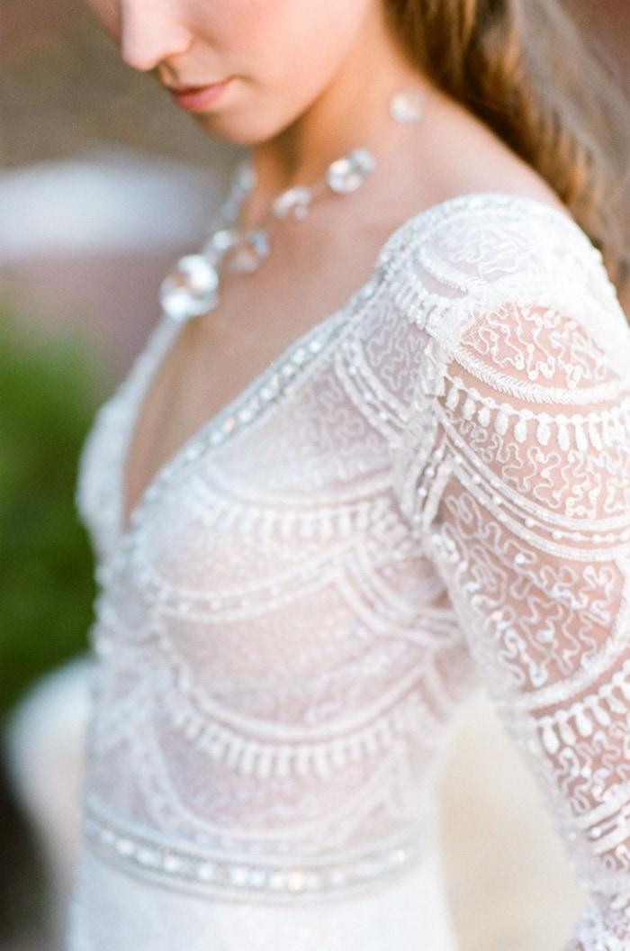 Close up of Berta Bridal wedding dress adorned with pearls