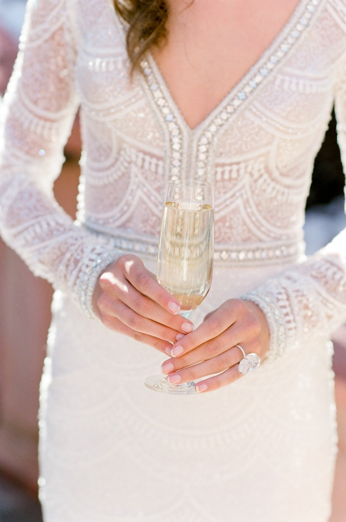 Woman in wedding gown holding glass