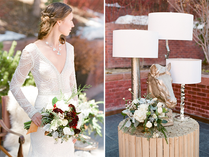 Bride looking off to the left holding bouquet of mixed flowers and table with lanterns and horse head statue on the right
