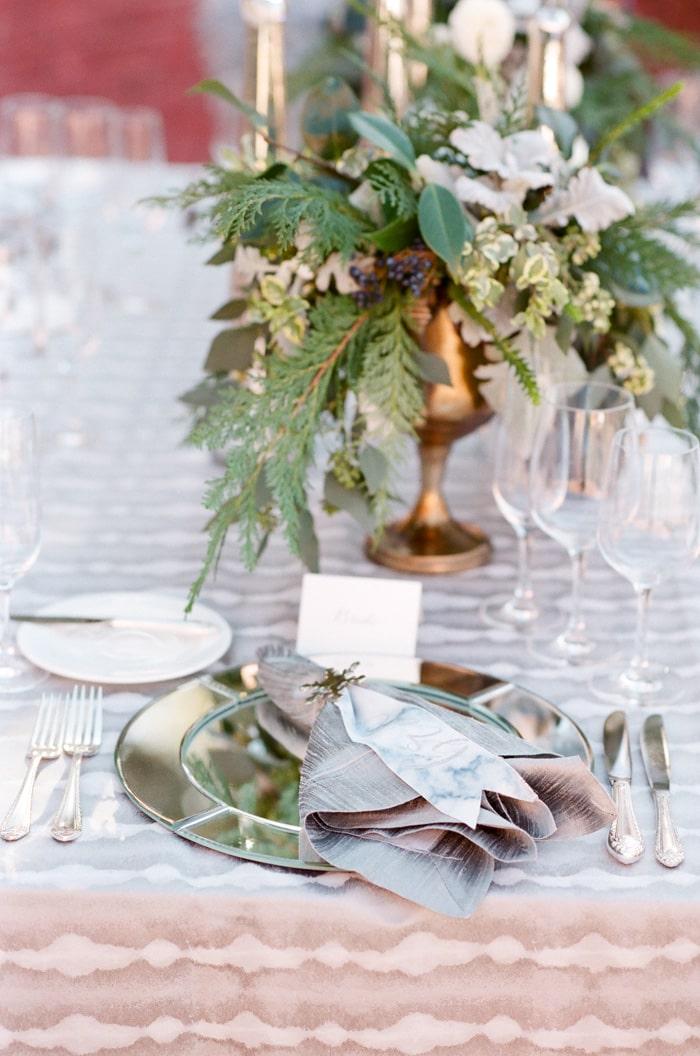 Fancy table setup for wedding reception dinner